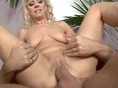 A blonde with natural tits receives a hard dick in her pussy