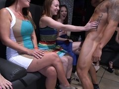 Stripping dude goes into the audience for blowjobs from hot sluts