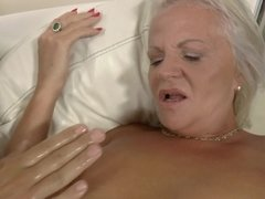 A blonde mature babe is getting her ass fucked after the footsie