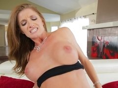 A big breasted bimbo with a firm young ass is getting fingered