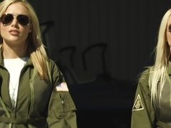 Hot blonde pilot is on her knees, doing a blow job to her collegue