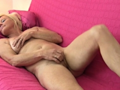 Old slut gives a striptease show with her big bra buddies