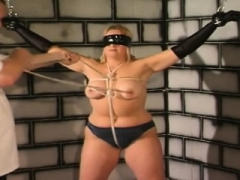 Rotund blonde slave gets wholly restrained in dungeon