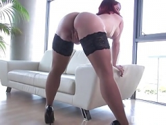 Charming Redhead With Big Tits Masturbates in Stockings