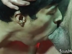 Hunky twink slave gives head to a mature SM stud