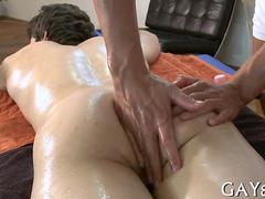 Oiled up guy lets his euro masseur do what he wants