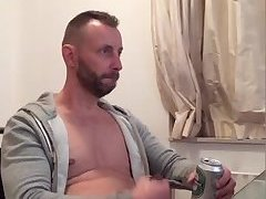 Hot thick straight dude enjoys a beer while jerking off