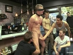 Blonde queer gets his ass and mouth fucked in group BDSM clip