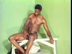 Hot black queer demonstrates his butt and plays with his wang