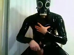 Awful Stud In Black Latex Suit
