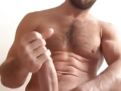 Hairy guy cums on the camera
