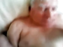 A gray-haired old man sucking another man's cock