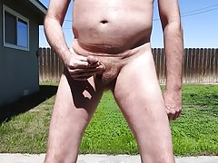 A daddy peeing in spurts.
