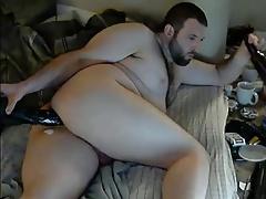 Beautiful bear enjoying a huge dildo