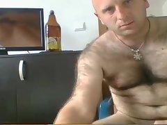 Hairy straight Slav beating his uncut cock