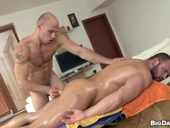Bulky bearded gay daddy enjoys bareback sex with a masseur