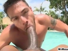 Bulky black cock sucked off in the pool