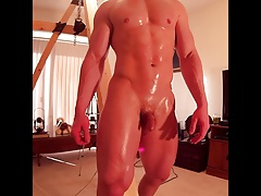Hunk oiled up and massaged flexing