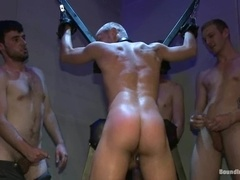 A blonde faggot gets beaten and fucked by his buddies in BDSM scene