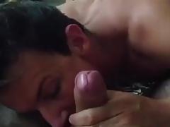 Young boy sucking an older man