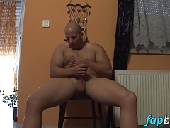 Lusty stud plays with his shaved schlong