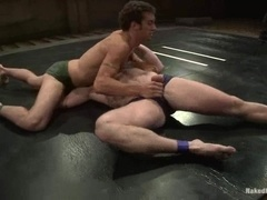 Muscular gays Dean Tucker and DJ wrestle and fuck on a ring