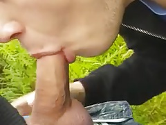 Twink sucking cock in the park and getting the cum