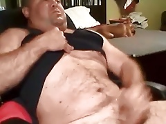 Chunky daddy stroking while puppy plays