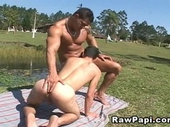 A hunk toys his buddy's ass before ripping it apart with his schlong