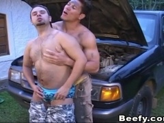 Two muscular guys drill each others asses after repairing a car