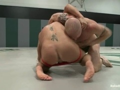 Lewd fag Luke Riley gets his ass spanked after a tussle on a ring