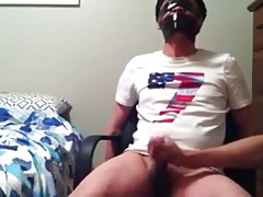 asian guy tied up , tape gagged and edge and jerked off