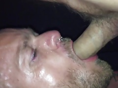 Sucking cum out of a tourist daddy in darkroom