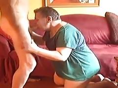 A sexy mature men sucking a young boy
