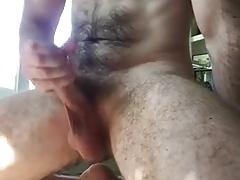 Hairy man cums on the floor