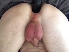 Twink gets fucked by black dildo machine