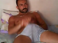 Hot turkish hunk wanking on bed