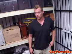 Pawnshop client in bdsm suit sucks dick