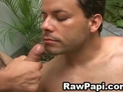 Hunky gay guy with short dark hair sucking a stranger's cock