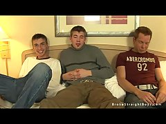 Trio wanking on the bed