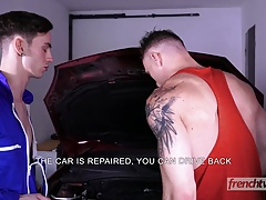 A young mechanic fucked on the hood of a car