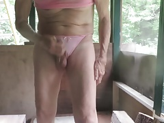 Man bitch pulls his panties down to masturbate and squirt.