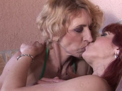 Three older lesbians and one hot foxy babe get it on