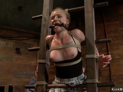 Fascinated blonde gets spanked on hogtie