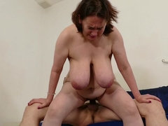 Mature housewife shows off big saggy tits and fucks her young boyfriend.