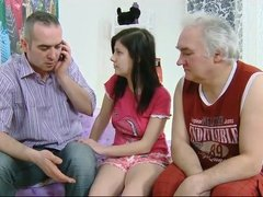 Threesome with two granddads and one innocent brunette
