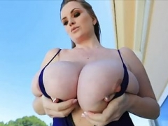 Sexually available mom in a swimsuit shows big boobs