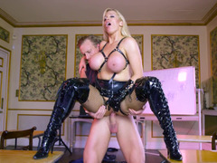 Blonde with large fake tits is sucking a big cock in leather