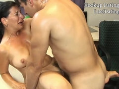 Young guy fucked brunette granny on the table