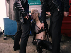 Punk slut in leather blows and bangs two horny guys